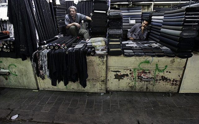 Textile merchants wait for customers in Tehran's old main bazaar on Saturday, July 14, 2012. (Vahid Salemi/AP)