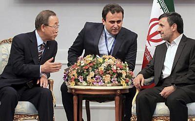 Ban Ki-moon, left, speaking to Mahmoud Ahmadinejad through a translator on Tuesday. (photo credit: (AP/Presidency Office, Mohsen Rafinejad)