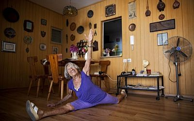 Agnes Keleti, a 91-year-old former Olympic gymnast, performs a split at her house in Herzliya, Israel, Monday, Aug. 13, 2012. (photo credit: Oded Balilty/ AP)