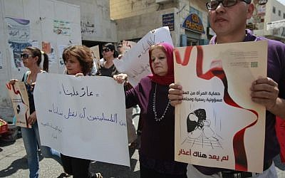 Palestinian women at a demonstration in 2012 protesting violence against women held at the spot where a woman's throat was allegedly slashed by her husband, in the West Bank town of Bethlehem. (AP/Majdi Mohammed)