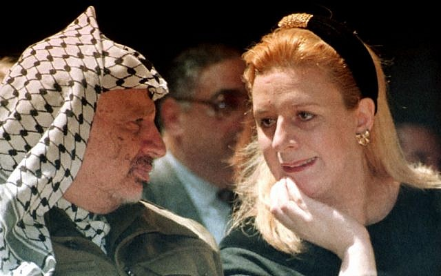 Suha Arafat, right, and late Palestinian leader Yasser Arafat attend a conference in the Gaza Strip in April, 1995 (photo credit: AP/Nabil Judah)