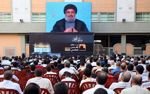 Hezbollah leader Sheikh Hassan Nasrallah speaks through a video link on the occasion of Jerusalem Day in the southern suburb of Beirut, Lebanon, August, 2010 (photo credit: AP Photo/Bilal Hussein)