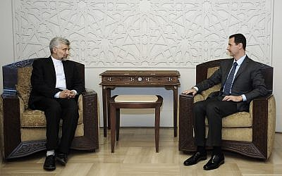 Syrian President Bashar Assad, right, meets with Saeed Jalili, secretary of Iran's Supreme National Security Council, in Damascus on August 7 (photo credit: AP/SANA)