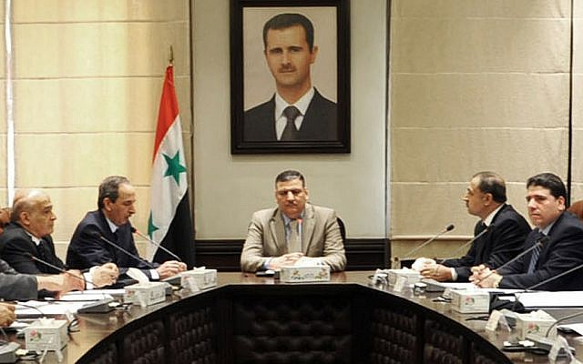 Riad Hijab heads a Syrian government meeting in an undated photo (photo credit: AP Photo/SANA)