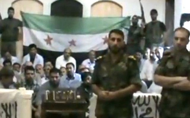 Free Syrian Army soldiers guarding a group of Iranians abducted on August 4, 2012 (photo credit: AP video/Baraa Brigades)