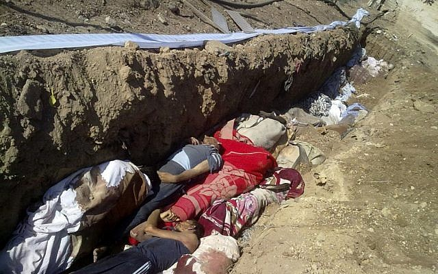 A citizen journalism image purports to show a mass grave in Daraya, Syria, August 26 (photo credit: AP/Shaam News Network)