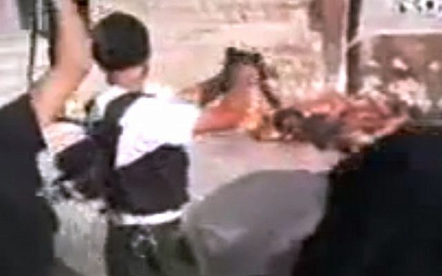 Amateur video purports to show Free Syrian Army soldiers executing Assad loyalists in Aleppo, Syria. (photo credit: Tabshoor1/AP)
