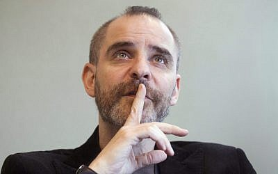 Author David Rakoff during an interview in Toronto in 2010. (AP Photo/The Canadian Press, Frank Gunn)