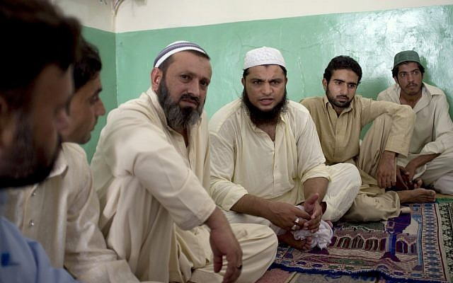 Cleric Hafiz Mohammad Zubair, third from right, meets with residents in a suburb of Islamabad, Pakistan at a local mosque on Monday, Aug. 20, 2012 regarding an alleged blasphemy by a Christian girl. (B.K. Bangash/AP)