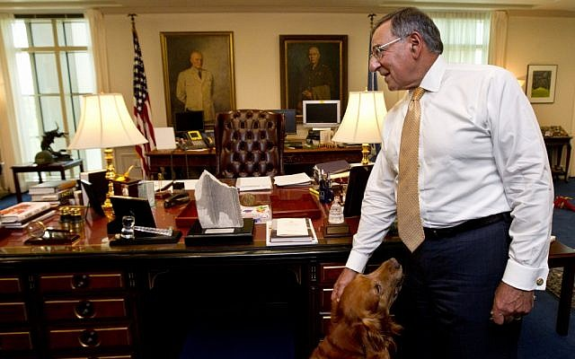 Defense Secretary Leon Panetta, with his golden retriever dog Bravo, during an interview with The Associated Press, Monday, Aug. 13, 2012, at the Pentagon. (photo credit: AP/ Manuel Balce Ceneta)