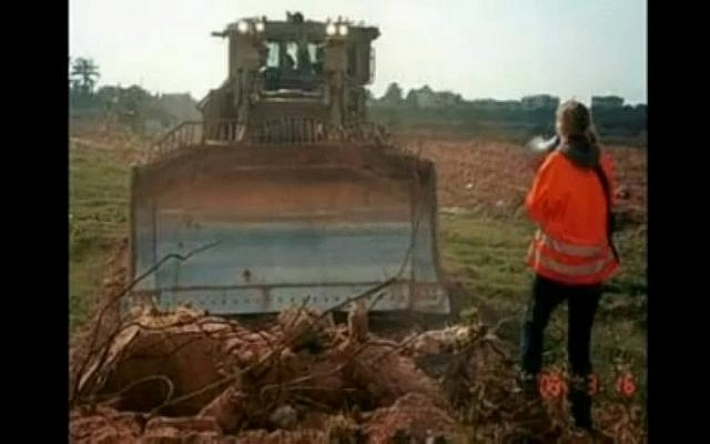 Rachel Corrie faces a bulldozer in Gaza (photo credit: image capture journeymanpictures/Youtube)