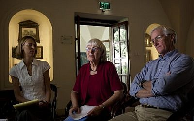 Cindy (center), and Craig Corrie (right), the parents of Rachel Corrie, with their daughter Sarah in Jerusalem, August 2012 (photo credit: AP/Sebastian Scheiner)