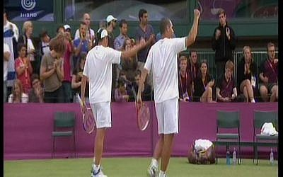 Israeli tennis duo Andy Ram and Jonathan Erlich celebrate after beating their Swiss rivals, Roger Federer and Stanislas Wawrinka, to make it to the quarterfinals in London (image capture Channel 1)
