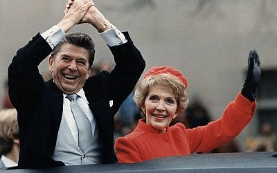 President Ronald Reagan, pictured with wife Nancy at his 1981 inauguration, is credited in a draft of the Republican Party platform as the source of a quotation by Rabbi Hillel. (Photo credit: From http://commons.wikimedia.org/wiki/File%3AThe_Reagans_waving_from_the_limousine_during_the_Inaugural_Parade_1981.jpg)