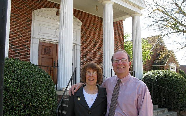 Rabbi Lynne Goldsmith and her husband, Rob Goldsmith, in front of their synagogue in Dothan, Ala., where Jews can receive up to $50,000 for relocating for at least five years. (Photo credit: Rob Goldsmith/JTA)