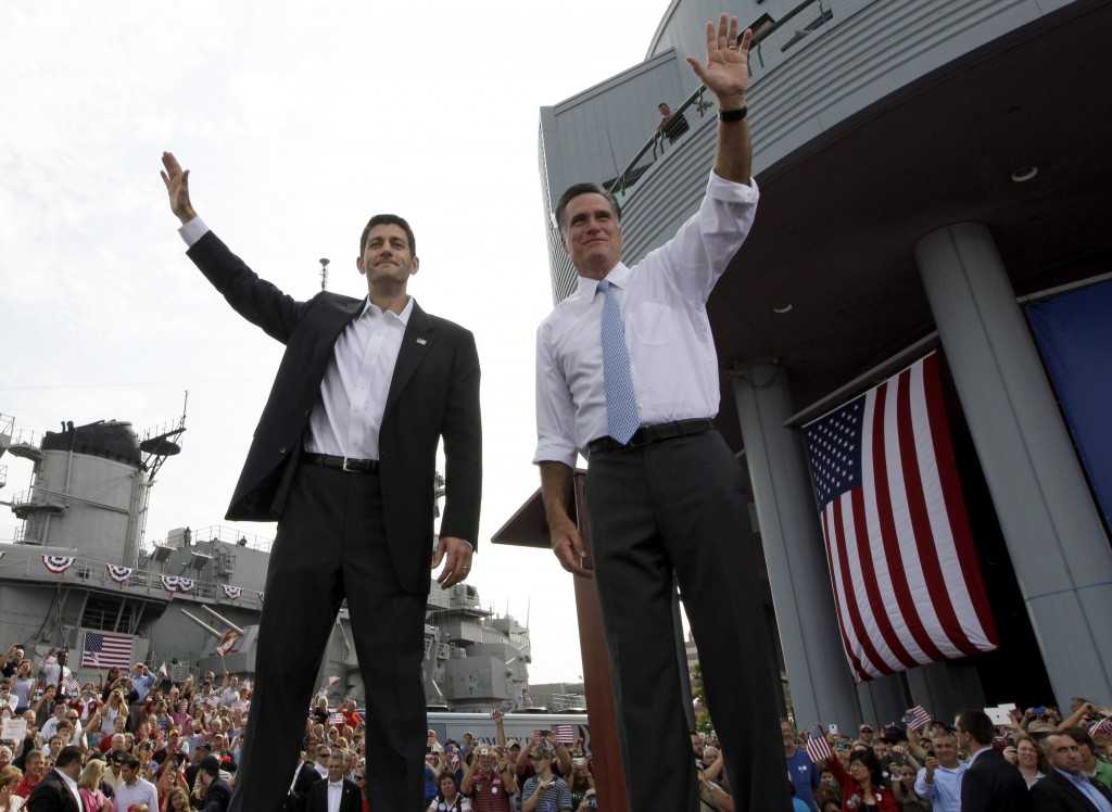 Republican presidential candidate, former Massachusetts Gov. Mitt Romney, right, and vice presidential candidate Wisconsin Rep. Paul Ryan, R-Wis., wave at the crowd during a campaign event, Saturday. (photo credit: AP)