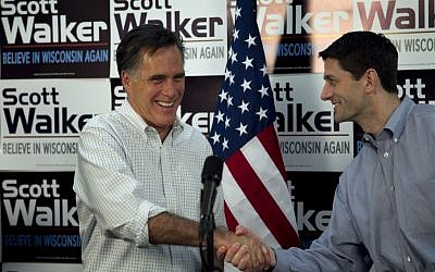 Republican presidential candidate, former Massachusetts Gov. Mitt Romney, left, shakes hands with US Rep. Paul Ryan, R-Wis., Chairman of the House Budget Committee, in March. (photo credit: AP/Steven Senne, File)