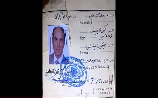 Papers purportedly identifying a man slain by Syrian rebels as being  Vladmir Petrovic, a general in the Russian army claimed to be advising Syrian regime forces. (screen capture jamalworkmail/Youtube)