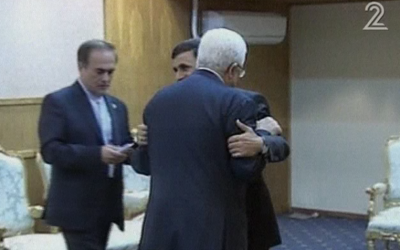 Former Iranian President Ahmadinejad hugs Palestinian Authority President Mahmoud Abbas in Tehran on August 31, 2012. ( Channel 2 screenshot)