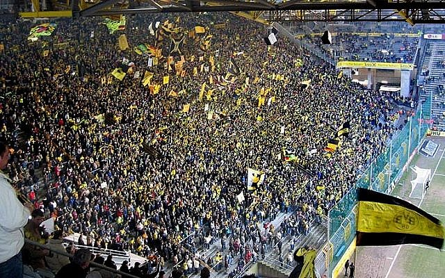 Fans at the Dortmund soccer stadium during a match (photo credit: CC BY Pascal Philp/Wikipedia)