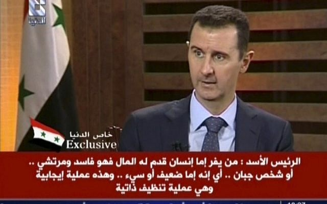 Syrian President Bashar Assad appears on Addounia TV, August 29 (photo credit: AP)