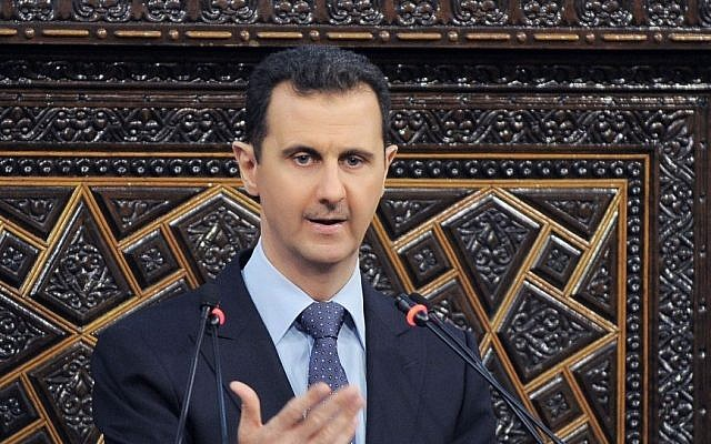 Syrian President Bashar Assad at the parliament in Damascus in June (photo credit: AP/SANA)