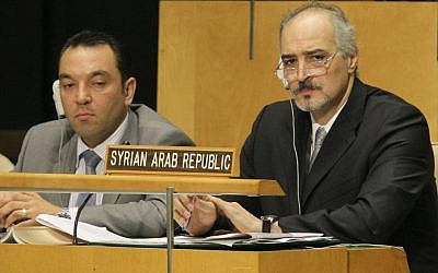 Syria's UN Ambassador Bashar Ja'afari, right, listens to speakers during a meeting of the UN General Assembly at the United Nations, in August. (photo credit: AP Photo/Kathy Willens)
