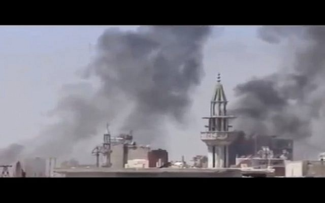 Smoke rises after regime shelling in Damascus (photo credit: screen capture highintheskyable/Youtube)