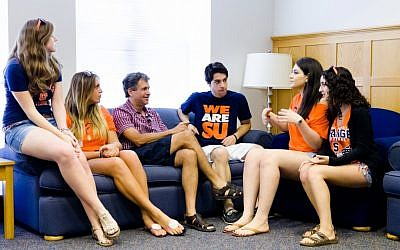 Hillel President Wayne Firestone, third form left, speaking with Syracuse University student outreach leaders at the Hillel Institute, hosted by Washington University in St. Louis, August 2012. (photo credit: Paul Granados/JTA)