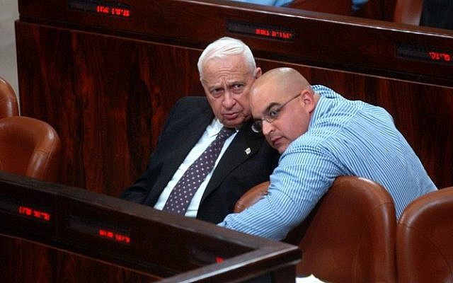 Ariel Sharon (left) with his son Omri at the Knesset (photo credit: Flash90)