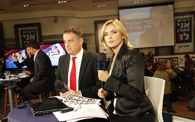 Emmanuel Rosen (left) with colleague Dana Weiss in a television studio in 2009. Rozen was recently detained in Libya while filming a documentary. (photo credit: Nati Shohat/Flash90)