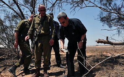 Defense Minister Ehud Barak and Gaza Division Commander Brig. Gen. Yossi Bachar on Monday at the scene of Sunday's attack (Photo credit: Courtesy: Defense Ministry)
