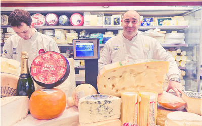 David Basher's brother, Eli, at their famous fromagerie in the shuk (Courtesy Basher's Fromagerie)