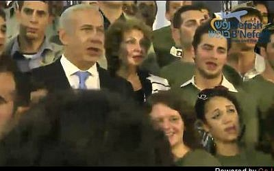 """Prime Minister Netanyahu and Minister of Immigrant Absorption Landver are joined at the end of Tuesday morning's ceremony in singing """"Hatikva"""" by 127 new immigrants who are to enlist in the IDF. (photo credit: Screen shot, Nefesh B'Nefesh live feed)"""
