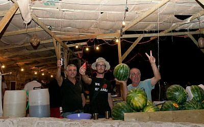 Benayun, Israeli and Ohayon working the watermelon stand (photo credit: Hamutal Wachtel)
