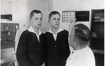 Dr. Otmar von Verschuer examines twins at the Kaiser Wilhelm Institute. As the head of the Kaiser Wilhelm Institute's Department for Human Heredity, Verschuer, a physician and geneticist, examined hundreds of pairs of twins to study whether criminality, feeble-mindedness, tuberculosis, and cancer were inheritable. In 1927, he recommended the forced sterilization of the 'mentally and morally subnormal.' Verschuer typified those academics whose interest in Germany's 'national regeneration' provided motivation for their research. (Photo credit: Archiv zur Geschichte der Max-Planck-Gesellschaft, Berlin-Dahlem)