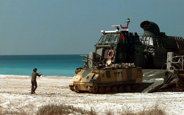 American soldiers offloading an Egyptian armored fighting vehicle during a joint exercise in Egypt in 2004. (Photo credit: Courtesy Department of Defense/Benjamin D. Olvey, U.S. Navy)