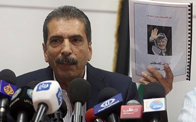 Palestinian investigator Tawfik Terawi at a press conference in Ramallah on Wednesday announced that Palestinian officials have invited Swiss experts to test Yasser Arafat's remains for possible poisoning. (photo credit: Issam Rimawi/Flash90)