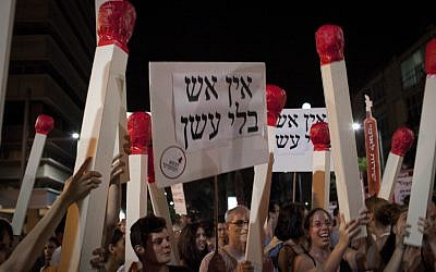 Thousands of Israelis take part in a protest march against the government's economic policy, Tel Aviv, Saturday. (photo credit: Tali Mayer/Flash90)
