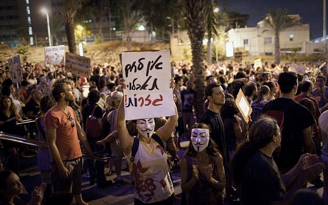 Protesters in Tel Aviv Saturday night. (photo credit: Tali Mayer/Flash90)