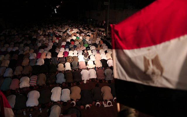 Gaza residents pray outside the Egyptian embassy in solidarity with Egypt following the attack (photo credit: Wissam Nassar/Flash90)