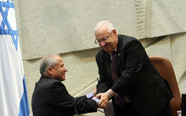 Knesset speaker Reuven Rivlin congratulates incoming Home Front Defense Minister Avi Dichter on Thursday (photo credit: Yoav Ari Dudkevitch/Flash90)