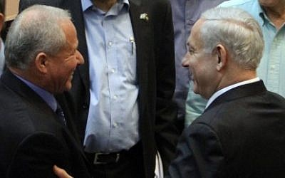 Avi Dichter is congratulated by Prime Minister Benjamin Netanyahu and other MKs after being appointed the new home front defense minister on August 16, 2012 (photo credit: Yoav Ari Dudkevitch/Flash90)