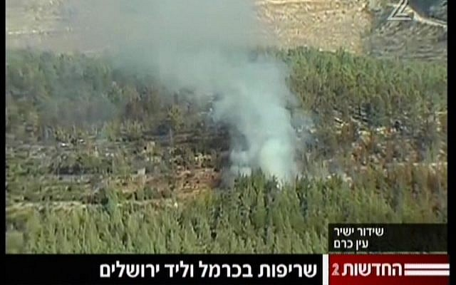 Fire rages near Moshav Even Sapir (image capture Channel2)
