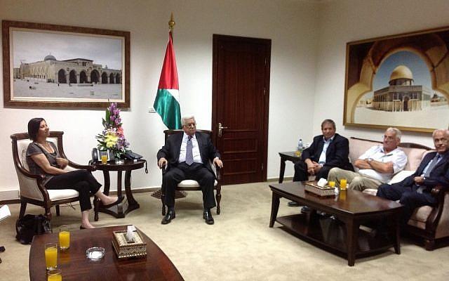 Meretz head Gal-On, left, talks with PA President Mahmoud Abbas in Ramallah (photo credit: Roy Yellin)