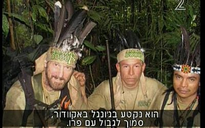 Grossman, left, in the jungle with his porters. (Screenshot: Channel 2)