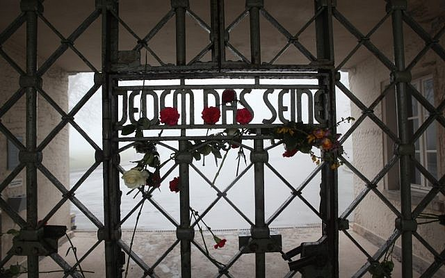 The front gate at Buchenwald whose inscription reads, 'To Each What He Deserves.' (Courtesy of Paul Paul Pugliese)