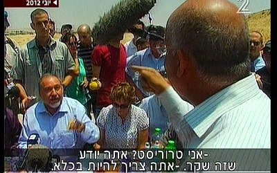 Taleb El Sana, back to camera, in a shouting match with Avigdor Liberman in June. (Screenshot: Channel 2)