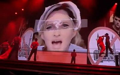 Madonna announced the removal of this swastika imagery from her stage show (photo credit: Youtube screen capture)