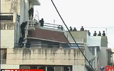 Indian commandos prepare to storm the Nariman House in Mumbai during the 2008 terror attacks. (photo credit: Youtube screen capture)